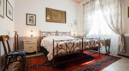 A bed or beds in a room at Casa Bertini