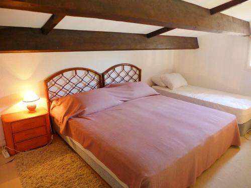 A bed or beds in a room at Apartment Haut des Issambres-12