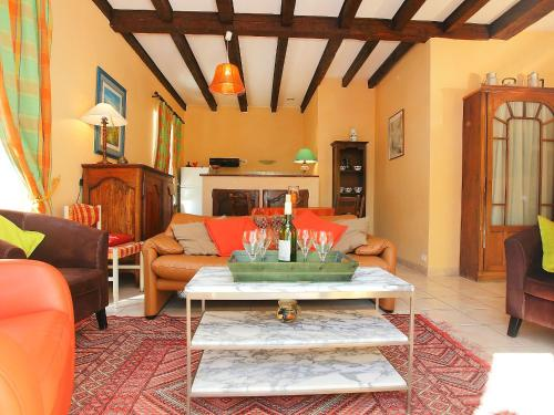 A seating area at Holiday Home La Colinoise