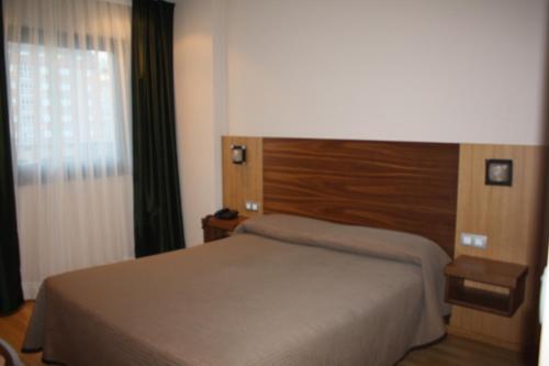 Letto o letti in una camera di Hotel Mar de Plata