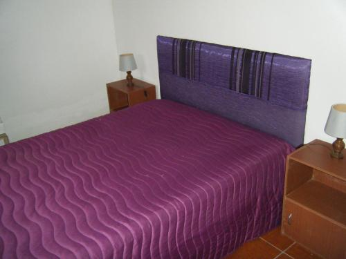 A bed or beds in a room at Casa da Costureira