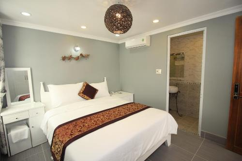 A bed or beds in a room at Nest Hotel