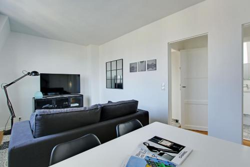 A seating area at Pick A Flat's Apartment in Saint Michel - rue du Sommerard