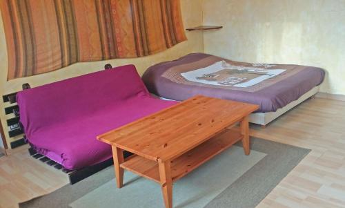 Un ou plusieurs lits dans un hébergement de l'établissement Studio Crosaz