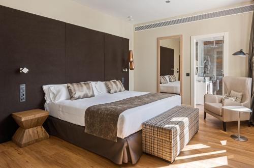 Ein Bett oder Betten in einem Zimmer der Unterkunft Catalonia Gran Vía