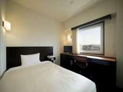 A bed or beds in a room at Hotel Mid In Akabane Ekimae