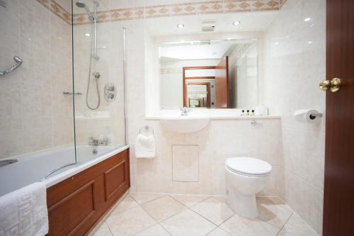 A bathroom at The Victoria Hotel Manchester by Compass Hospitality