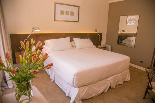 Cama o camas de una habitación en Hotel Costa Real