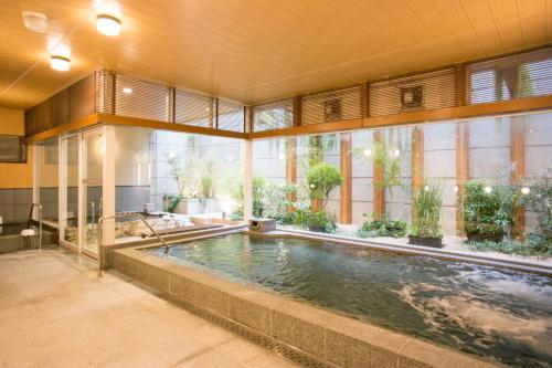 The swimming pool at or near Nishitetsu Hotel Croom Hakata