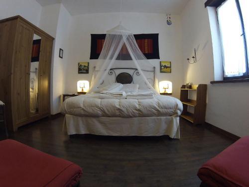 A bed or beds in a room at C'era Una Volta
