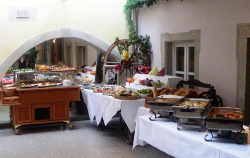 Ein Restaurant oder anderes Speiselokal in der Unterkunft Meister BÄR HOTEL Ostbayern