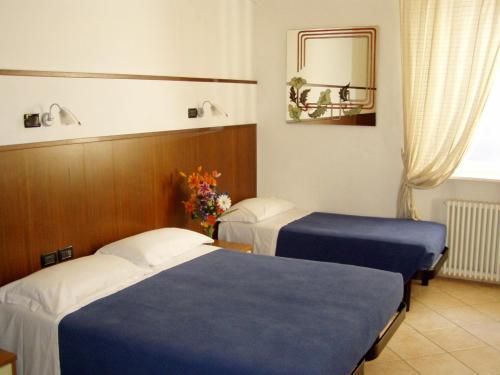 Un ou plusieurs lits dans un hébergement de l'établissement Affittacamere Paradise