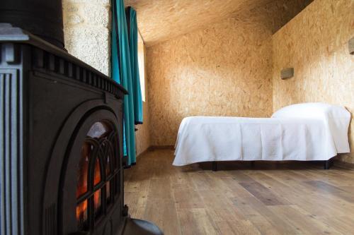 Cama o camas de una habitación en Casa do Comediante