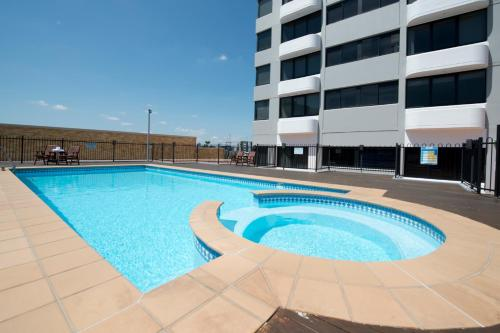 The swimming pool at or near Park Regis North Quay
