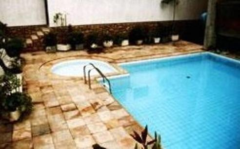 The swimming pool at or near Hotel Vitoria Palace