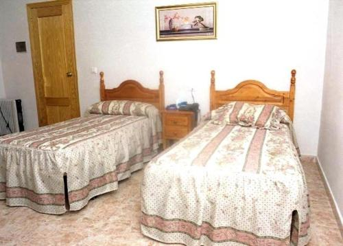 A bed or beds in a room at Hotel Limas