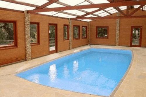 A piscina localizada em Hotel Pião Mineiro ou nos arredores