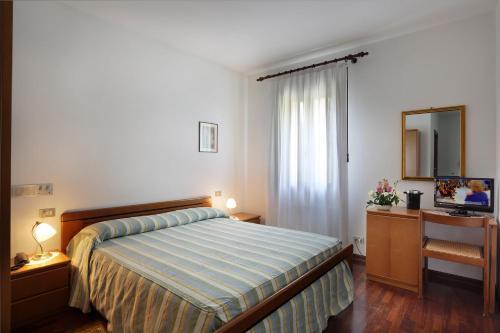 Letto o letti in una camera di Albergo Volpara