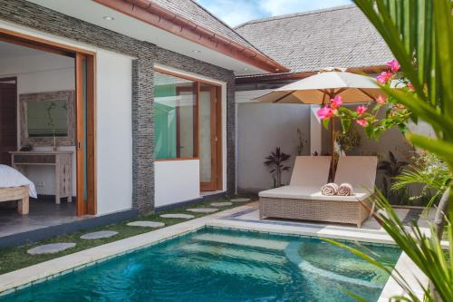 The swimming pool at or near Two Lizards Beach Villas
