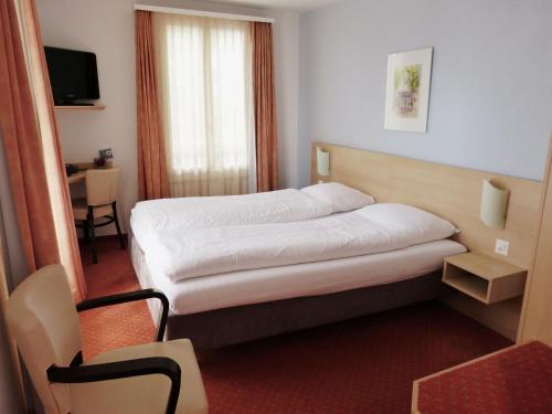 Ein Bett oder Betten in einem Zimmer der Unterkunft Hotel Rigi Vitznau