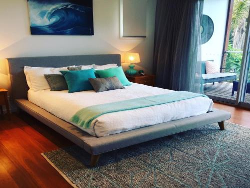 A bed or beds in a room at Drifted Away