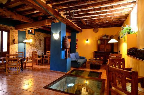 A restaurant or other place to eat at Caserón De La Fuente