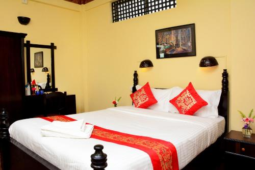 A bed or beds in a room at Dream Nepal Hotel and Apartment