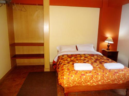 A bed or beds in a room at Hatun Wasi Huaraz