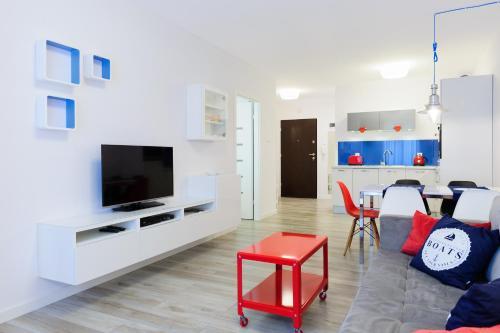 Telewizja i/lub zestaw kina domowego w obiekcie Apartamenty Mapio w Kołobrzegu