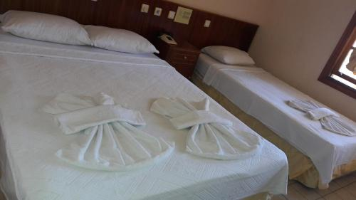 A bed or beds in a room at Hotel 47 Icmeler