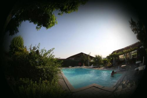 The swimming pool at or near Le Soleil