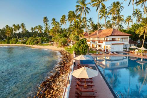 The swimming pool at or near Dickwella Resort and Spa