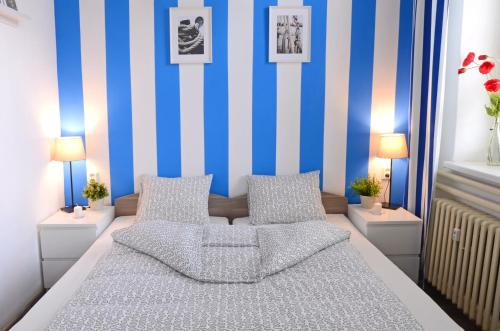 A bed or beds in a room at Apartmány Lanna
