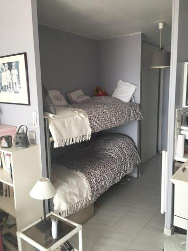 A bunk bed or bunk beds in a room at Studio Residence Les Algues - Place Foch