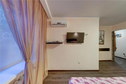 A television and/or entertainment center at InnHome Apartments Evteeva Street 5