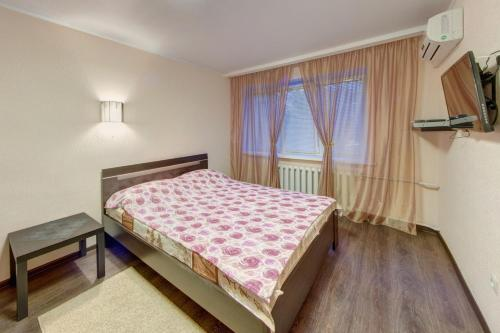A bed or beds in a room at InnHome Apartments Evteeva Street 5