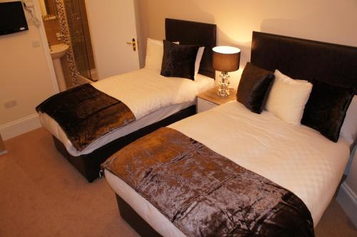 A bed or beds in a room at Sapphire Hotel London