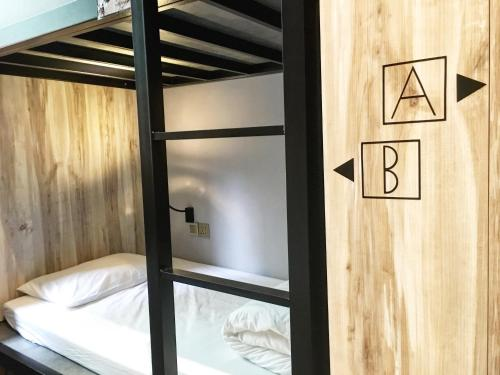 A bunk bed or bunk beds in a room at LuckyOne Hostel