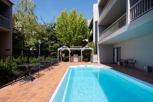 The swimming pool at or near Pinnacle Apartments