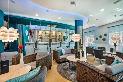 The lounge or bar area at Velamar Boutique Hotel