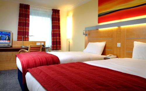 A bed or beds in a room at Holiday Inn Express London Golders Green, an IHG Hotel