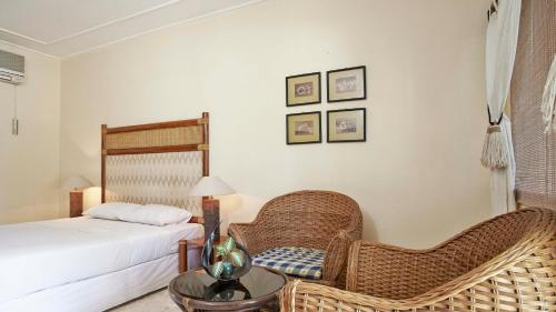 A bed or beds in a room at GEC Rinjani Golf and Resort