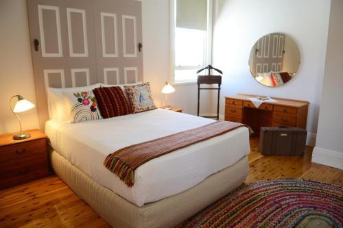 A bed or beds in a room at The Bank B&B West Wyalong