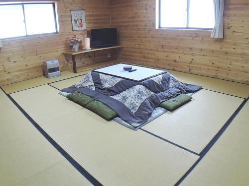 A bed or beds in a room at Sendaiya