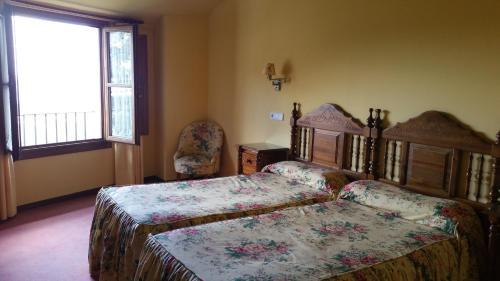 A bed or beds in a room at Puerta de la Villa