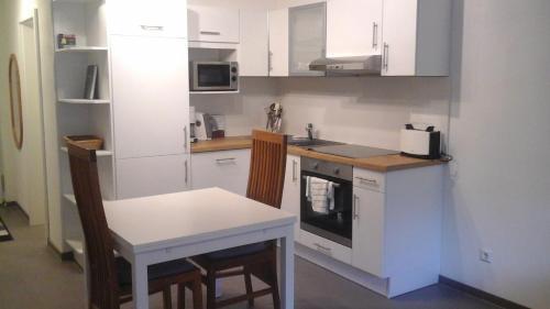 Küche/Küchenzeile in der Unterkunft Ferienwohnung Im Weihergrund