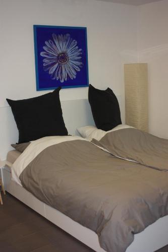Ein Bett oder Betten in einem Zimmer der Unterkunft Ferienwohnung Im Weihergrund