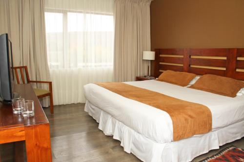 A bed or beds in a room at Hotel Limari