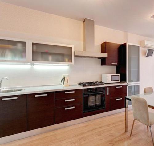 A kitchen or kitchenette at Business Apartments on Chistopolskaya