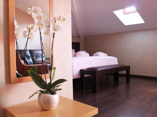 Cama o camas de una habitación en The Cookbook Gastro Boutique Hotel & SPA